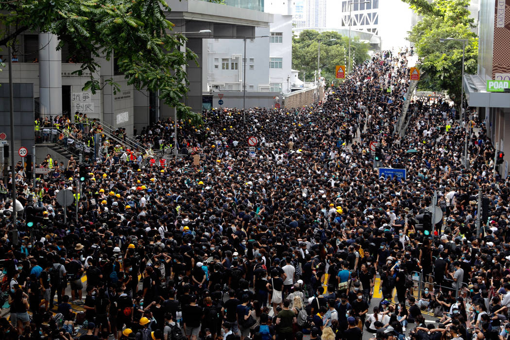 Protesters gather outside the police headquarters in Hong Kong Friday, June 21, 2019. Several h ...