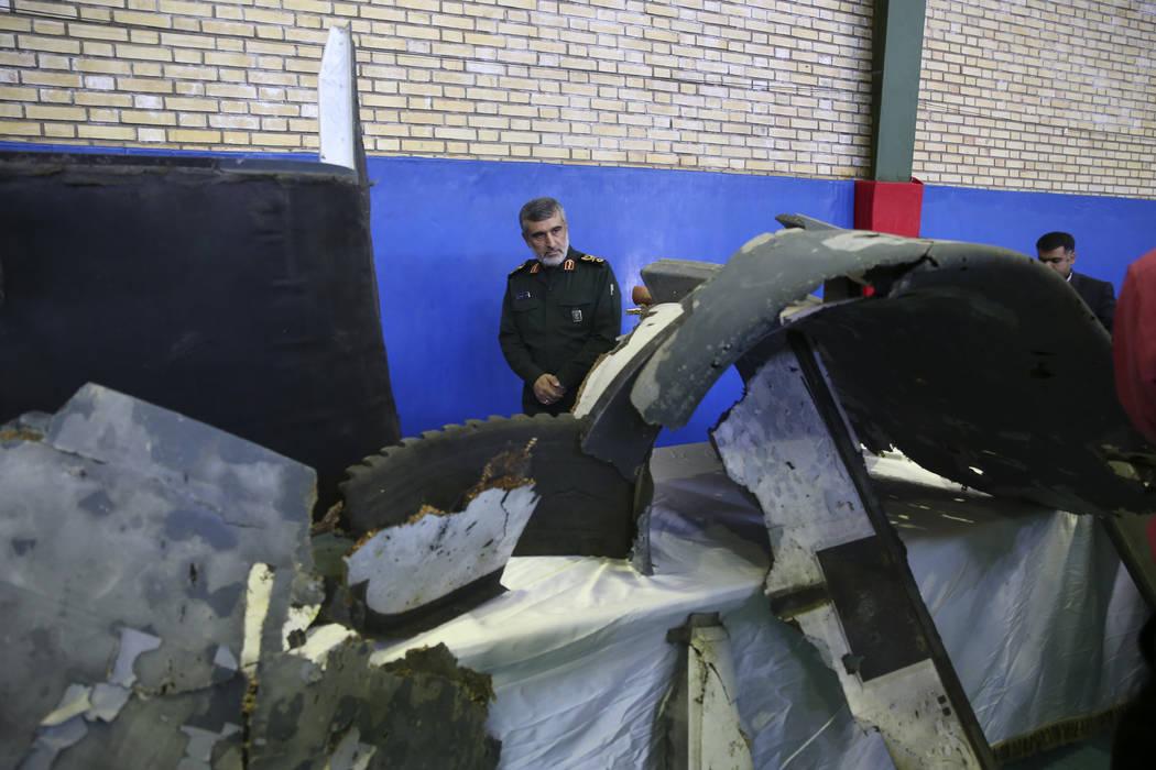 Head of the Revolutionary Guard's aerospace division Gen. Amir Ali Hajizadeh looks at debris fr ...