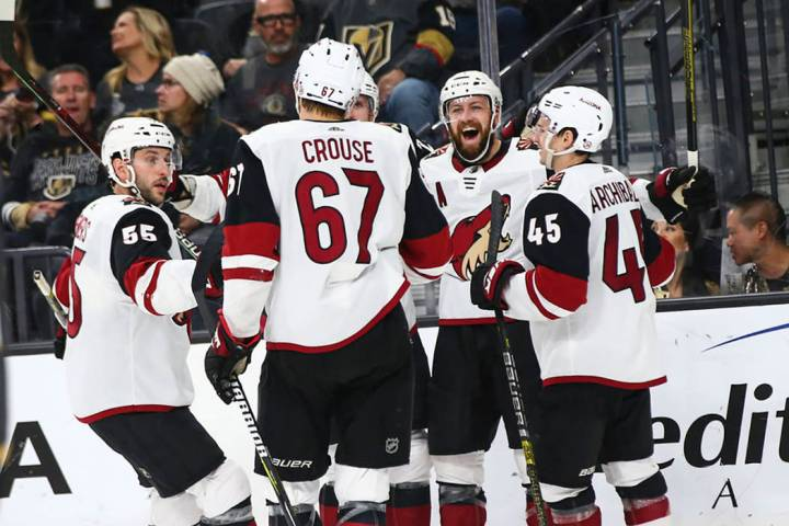 Arizona Coyotes players celebrate their third goal against the Golden Knights during the second ...