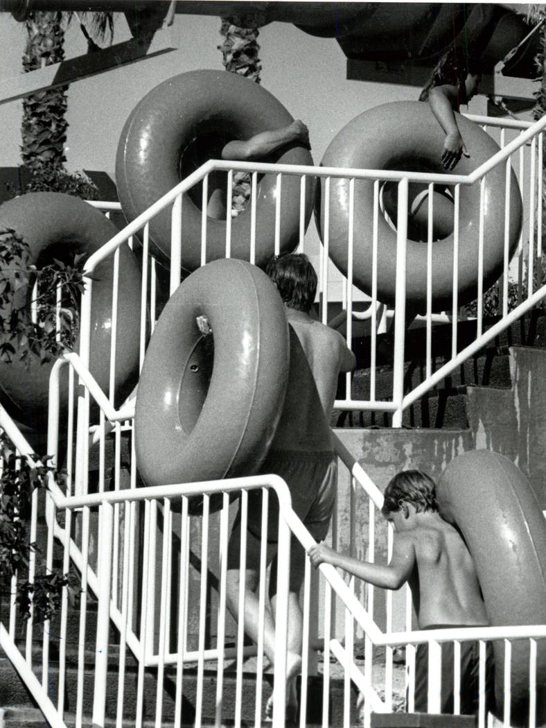 Riders carry innertubes to the top of a ride at Wet'n'Wild on Las Vegas Boulevard. (Dan Euoff/L ...