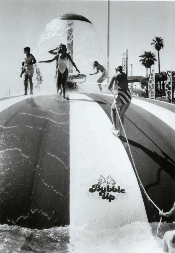 Attendees try to race to the top of the Bubble Up attraction at Wet'n'Wild on Las Vegas Bouleva ...