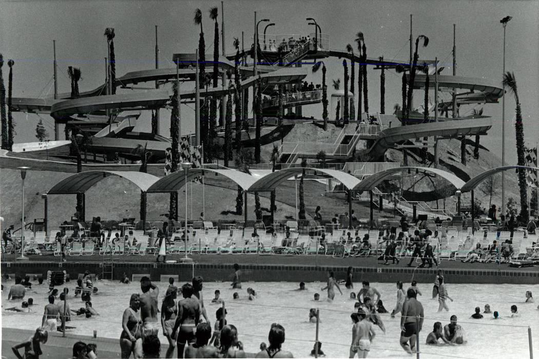 Guests keep cool by enjoying various activities at Wet 'n' Wild on Las Vegas Boulevard in 1985. ...