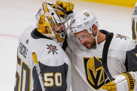 Vegas Golden Knights goaltender Zach Fucale (50) smiles as Brooks Macek (10) congratulates him ...