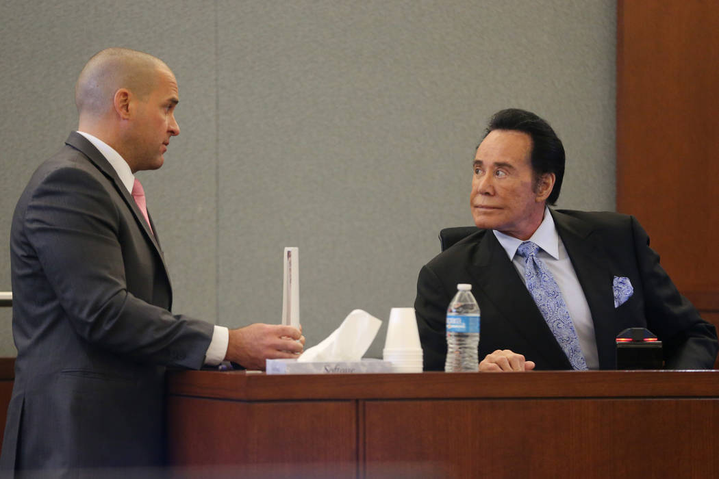 District Attorney John Giordani, left, speaks to Wayne Newton during the trial of Weslie Martin ...