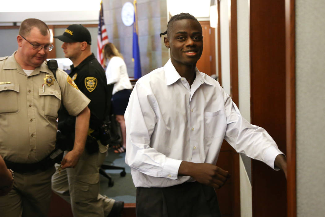 Weslie Martin is escorted out of a courtroom at the Regional Justice Center in Las Vegas on Fri ...