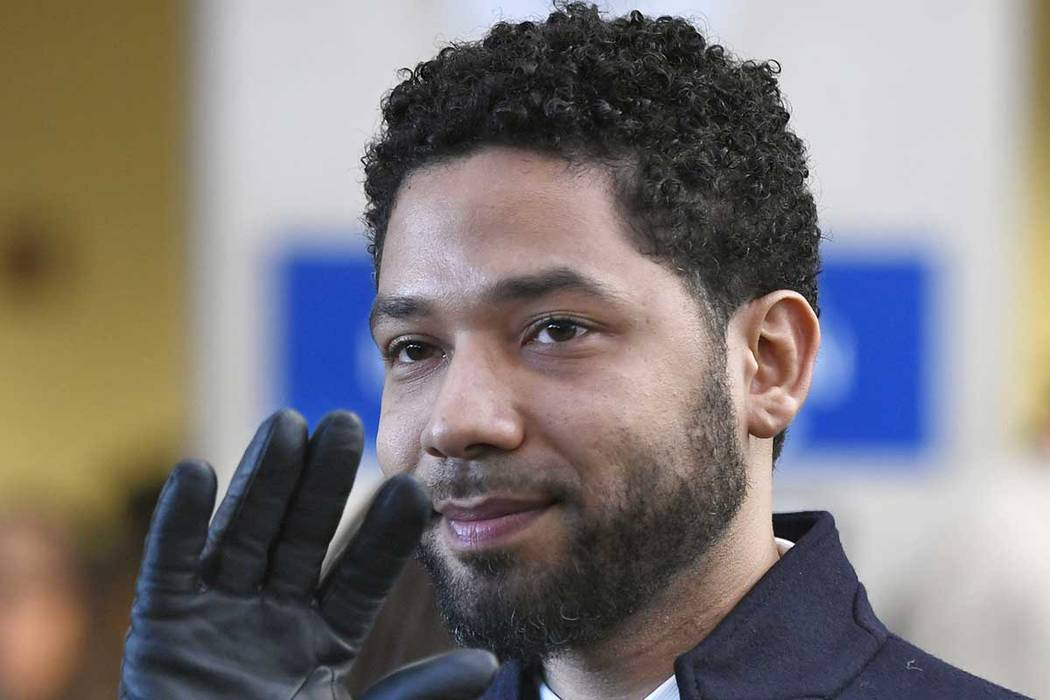 Actor Jussie Smollett smiles and waves to supporters before leaving Cook County Court after his ...