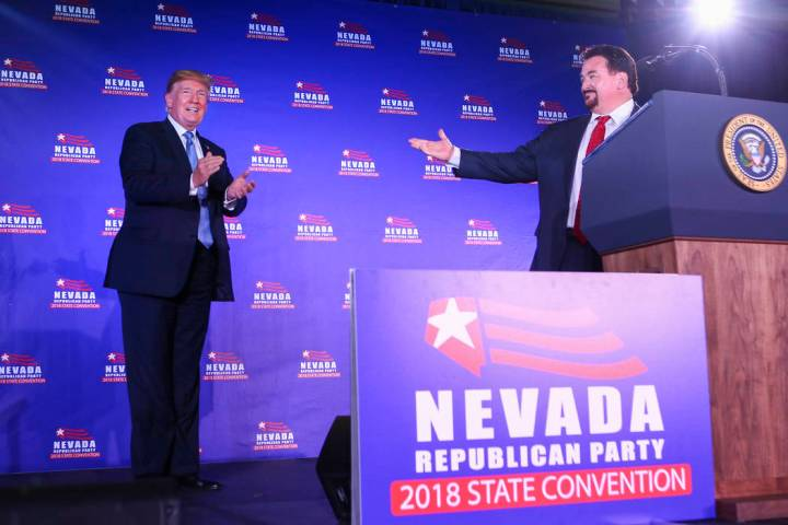 President Donald Trump is introduced by Nevada Republican Party Chairman Michael McDonald durin ...