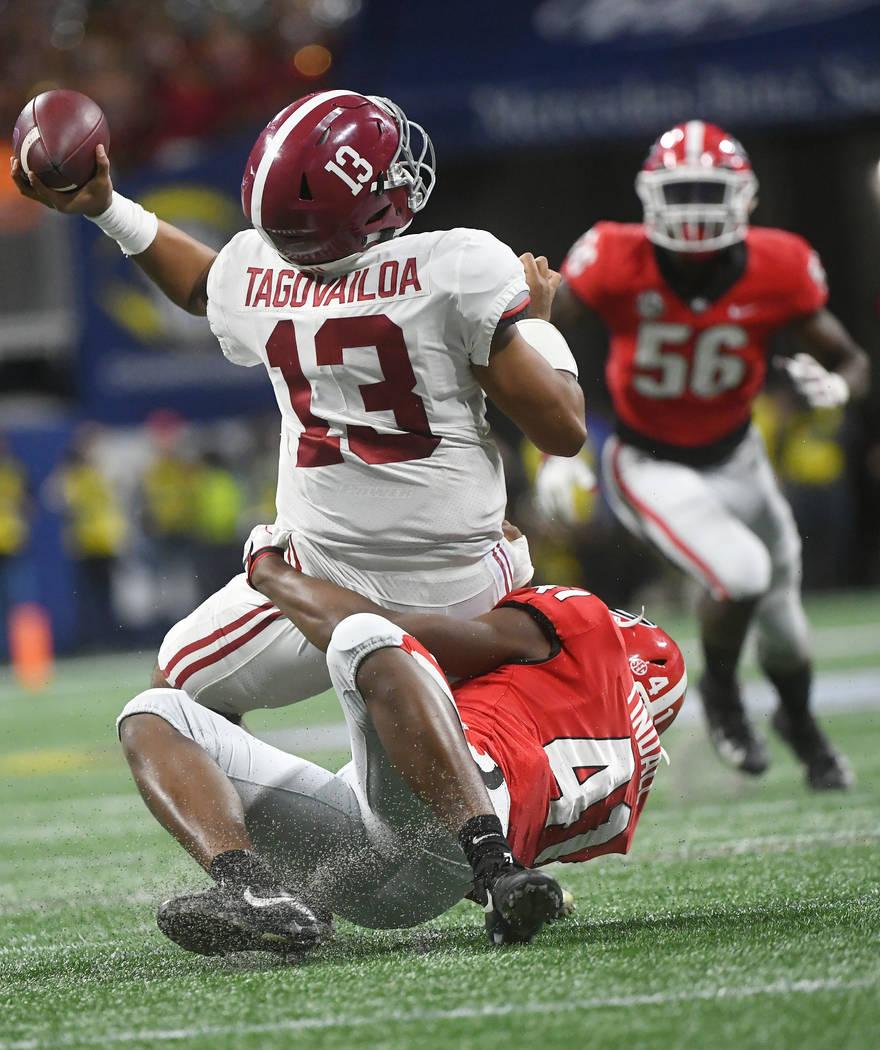 Georgia linebacker Channing Tindall (41) hits Alabama quarterback Tua Tagovailoa (13) during th ...