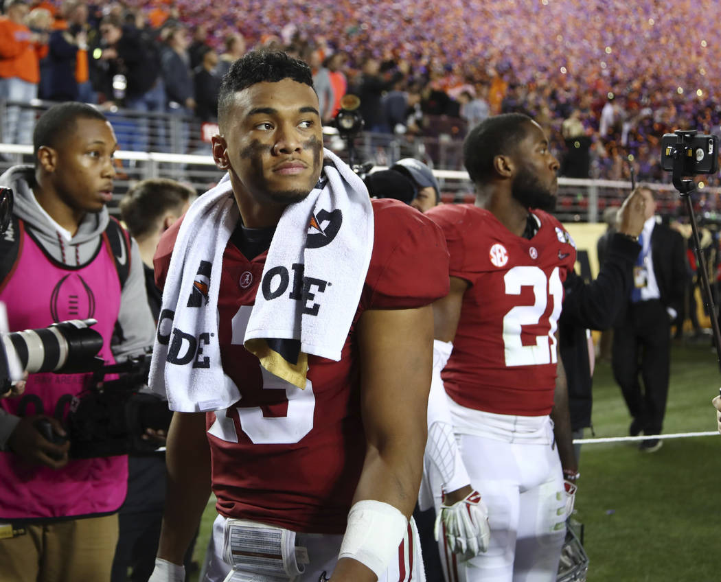 Alabama's Tua Tagovailoa reacts after the NCAA college football playoff championship game again ...