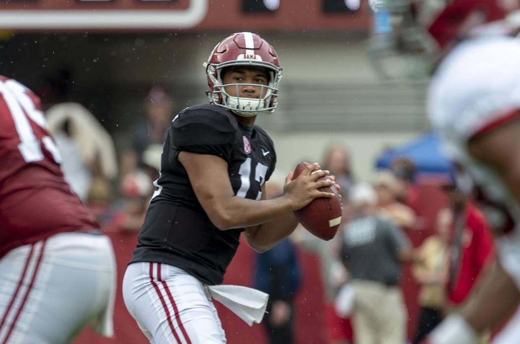 Alabama quarterback Tua Tagovailoa (13) drops back to pass during the second half of Alabama's ...