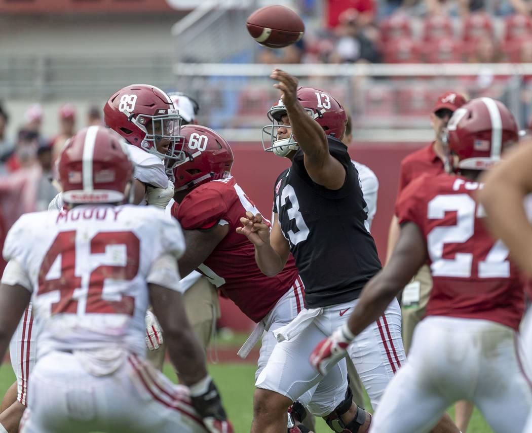 Alabama quarterback Tua Tagovailoa (13) throws in traffic during the second half of Alabama's A ...