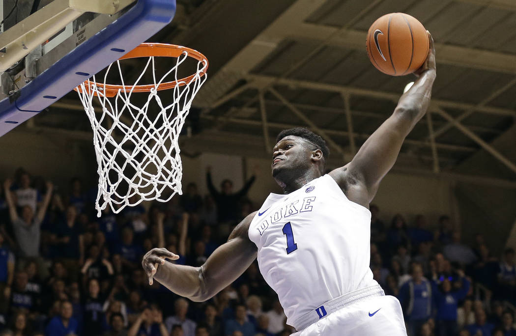 FILE - In this Jan. 5, 2019, file photo, Duke's Zion Williamson (1) dunks during the second hal ...