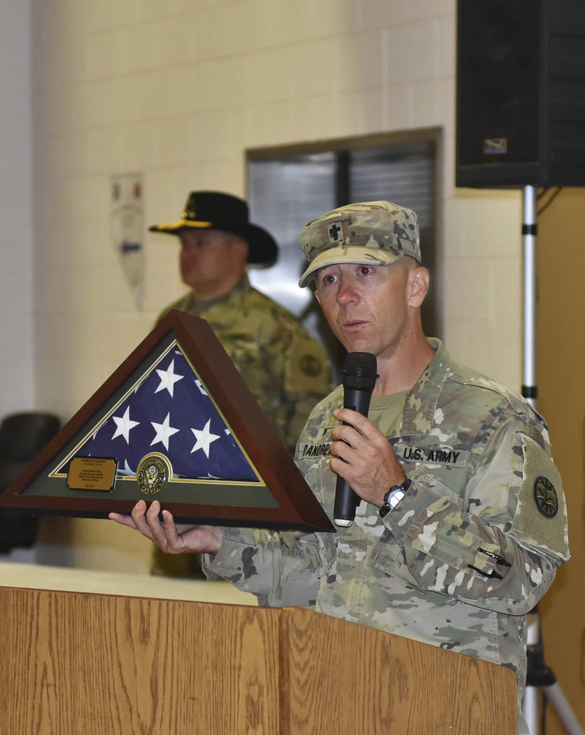 Nevada Army Guard chaplain Capt. Troy Dandrea holds the flag that will be permanently displayed ...