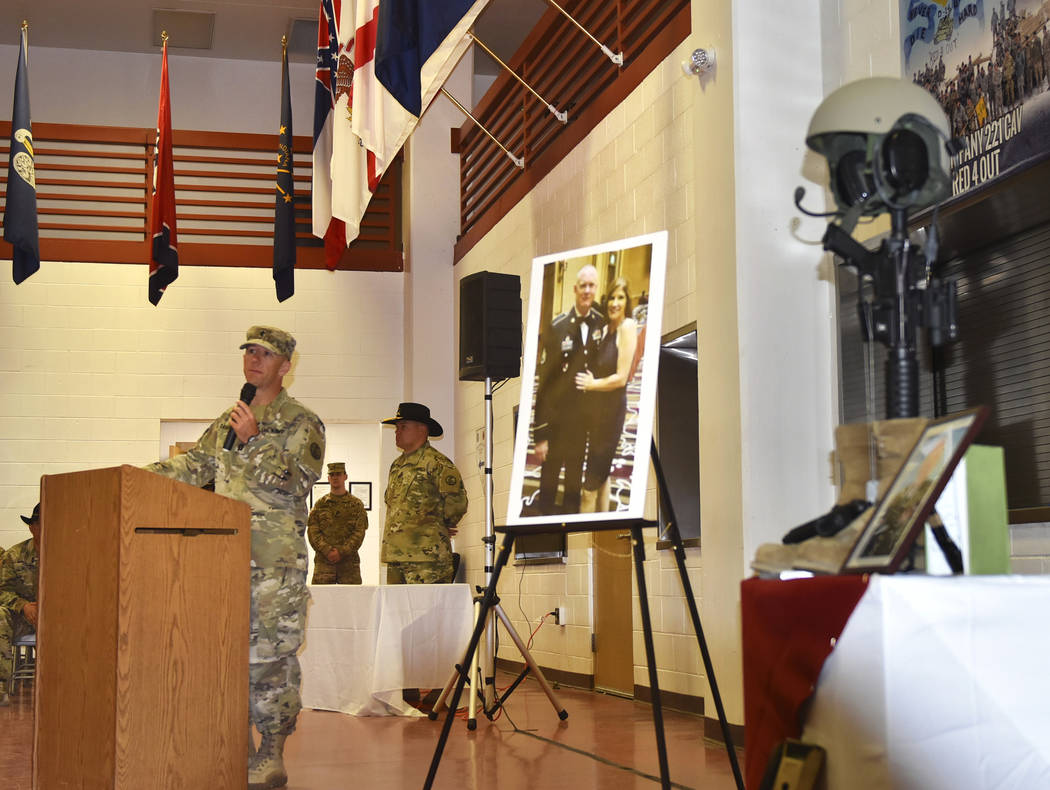 Nevada Army Guard chaplain Capt. Troy Dandrea delivers a memorial message during a ceremony for ...