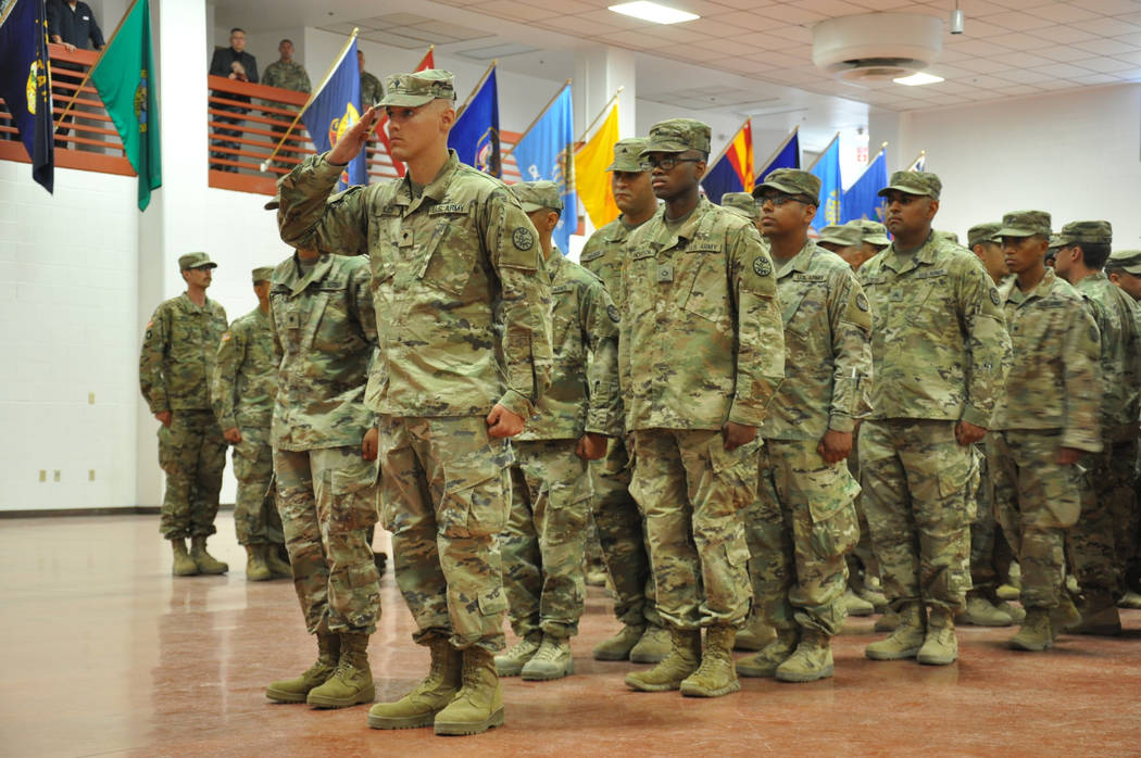 Soldiers from the Nevada Army Guard's 1st Squadron 221st Calvary pay their final respects ...
