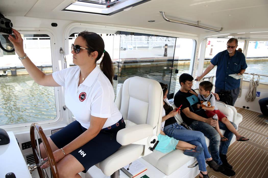 Captain Jacqueline Saba pilots a luxury harbor shuttle on the Mystic River near Encore Boston H ...