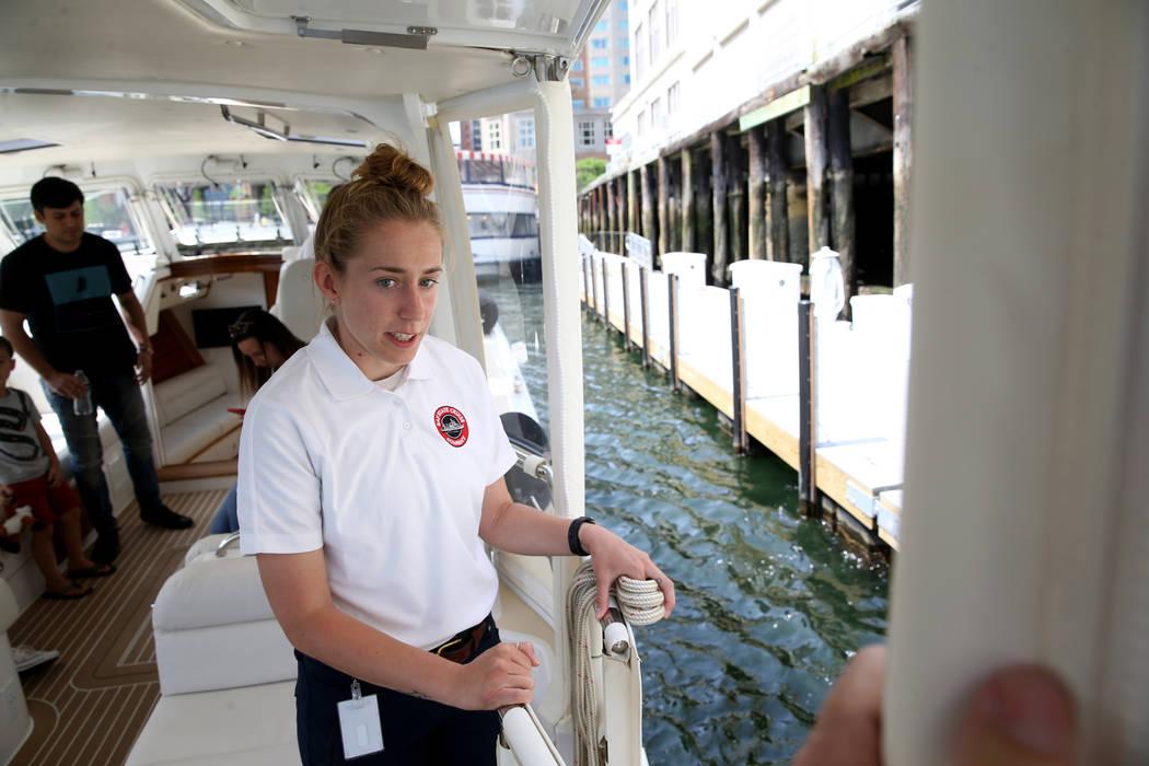 Crew member Katelyn Stimpson prepares to tie a luxury harbor shuttle from Encore Boston Harbor ...