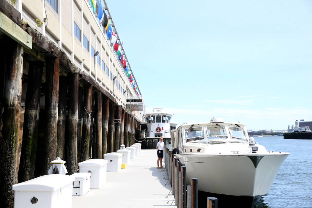 Crew member Katelyn Stimpson ties a luxury harbor shuttle from Encore Boston Harbor in Everett, ...