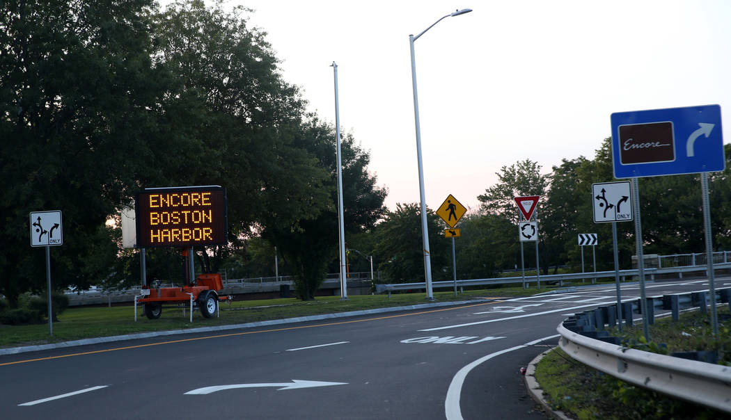 Signs direct traffic for the opening of the $2.6 billion Encore Boston Harbor in Everett, Mass. ...