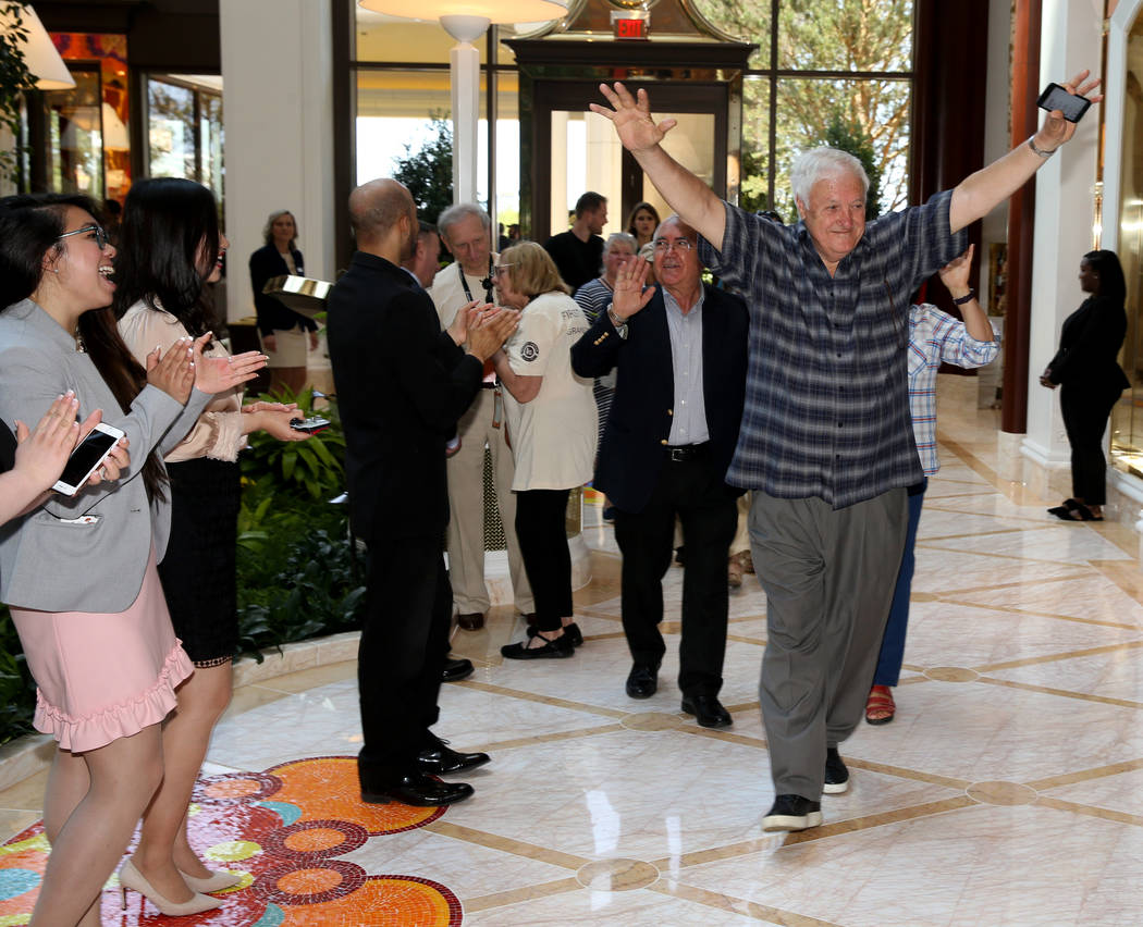 Employees cheer as Frank Susi of Boston arrives in the Garden Lobby during the opening of the $ ...