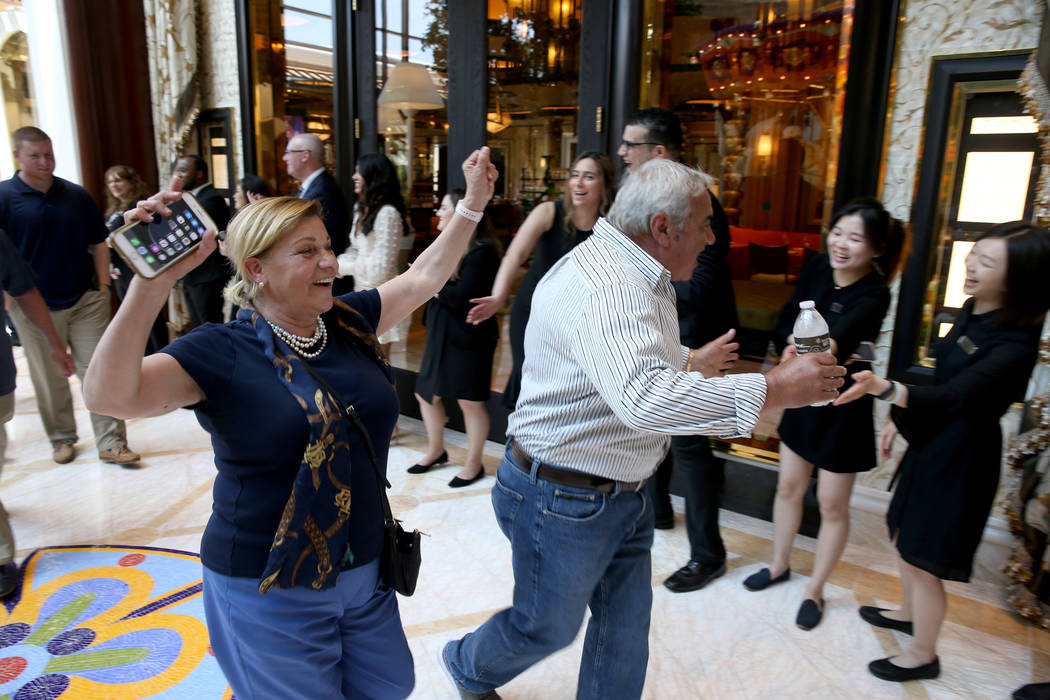 Employees cheer as Cristina and Tony Digiancomo, of Saugus, Mass., arrive in the Garden Lobby d ...