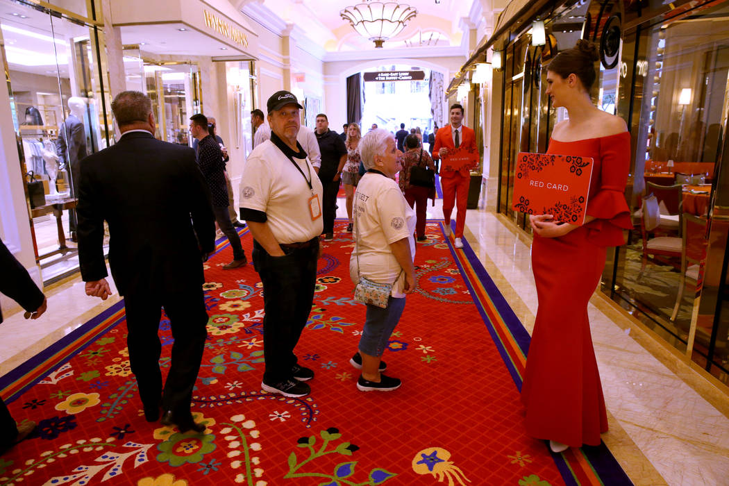 Morgan Furber and Marek Zybert direct guest to the Red Card signup area during the opening of t ...