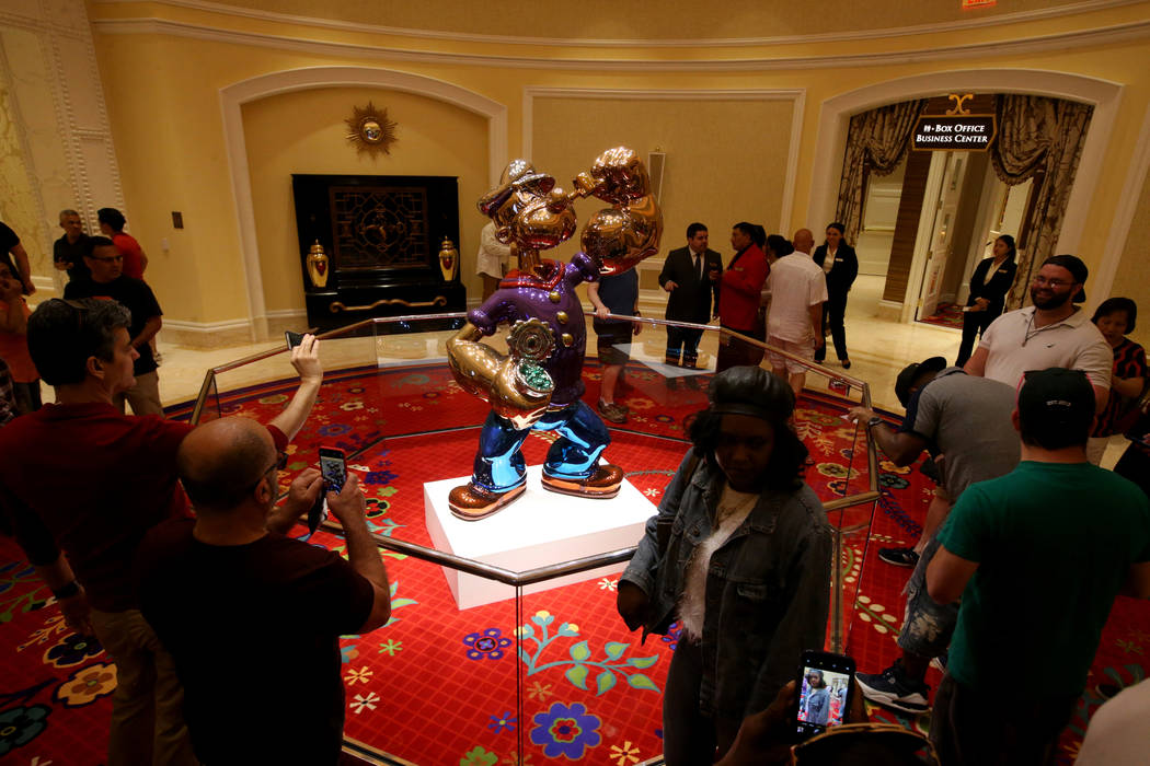 Guests check out Jeff Koons' Popeye statue on opening day of the $2.6 billion Encore Boston Har ...