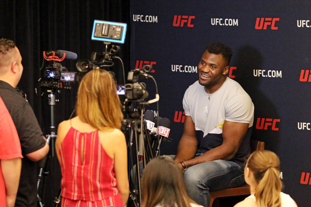 UFC heavyweight Francis Ngannou responds to questions during a media scrum at the UFC Performan ...