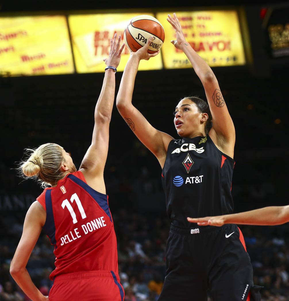 Las Vegas Aces center Liz Cambage (8) shoots over Washington Mystics forward Elena Delle Donne ...