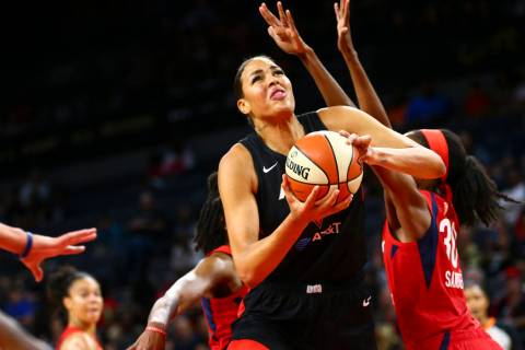 Las Vegas Aces center Liz Cambage (8) drives past Washington Mystics forward LaToya Sanders (30 ...