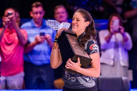 Danielle McEwan is overcome with emotion while holding the trophy after edging out Tanya Roumim ...