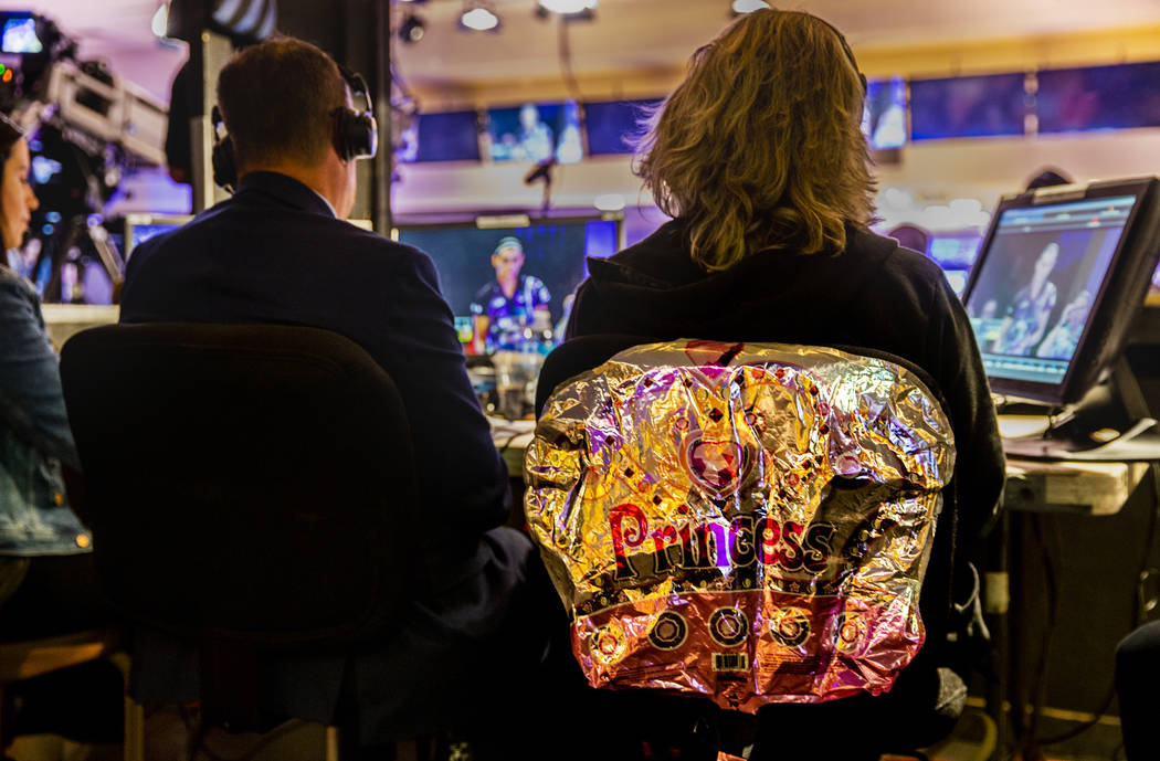 Announcer and former pro player Kelly Kulick has a princess balloon attached to her chair durin ...