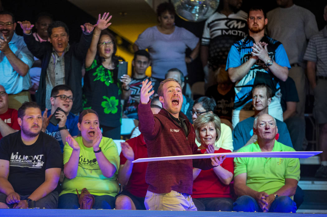 Brant Houghton with the USBC gives away tournament placards to the loudest fans during the U.S. ...