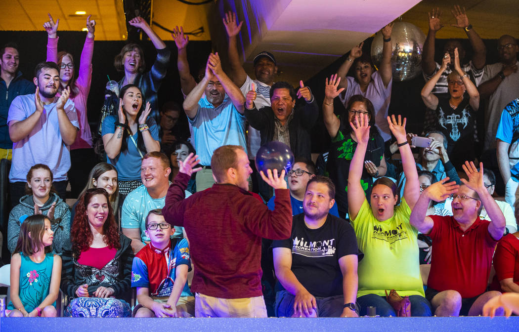 Brant Houghton with the USBC gives away player's bowling balls to the loudest fans during the U ...
