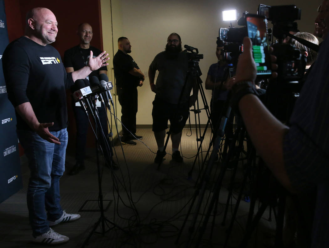 Ultimate Fighting Championship president Dana White talks to the news media about the opening w ...
