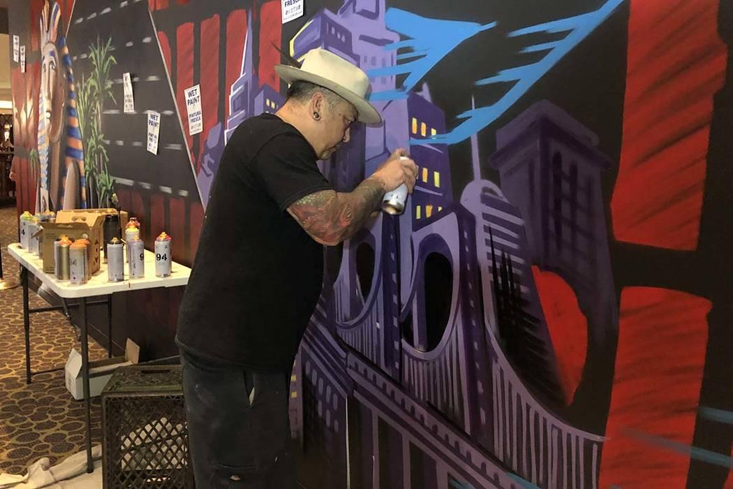 "Jay James, aka Tiki Jay One, works on the ""R.U.N"" art installation at Luxor on Friday, June 21, ..."