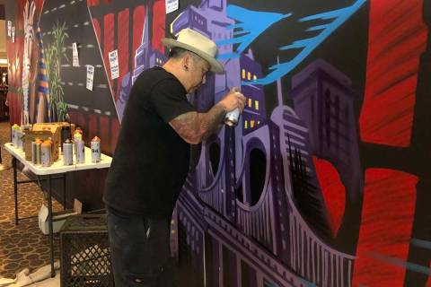 "Jay James, aka Tiki Jay One, works on the ""R.U.N"" art installation at Luxor on Friday, June 21, ..."