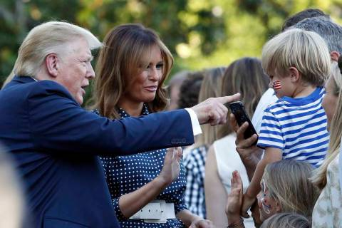 President Donald Trump and first lady Melania Trump greet attendees of the annual Congressional ...
