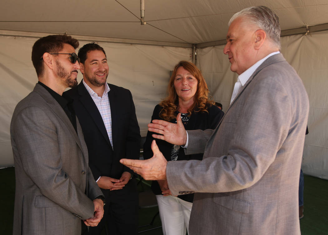 (From Left to Right) Rob Roy, CEO of Switch, Clark County Commissioner Mike Naft, Commissioner ...