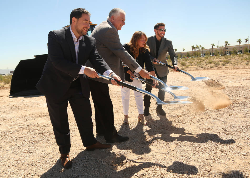 (From right to left) Rob Roy, CEO of Switch, City Commissioner Marilyn Kirkpatrick, Nevada Gove ...