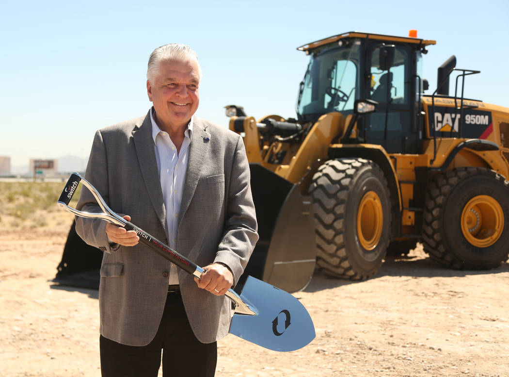 Nevada Governor Steve Sisolak poses after the shovel toss during the groundbreaking expansion c ...