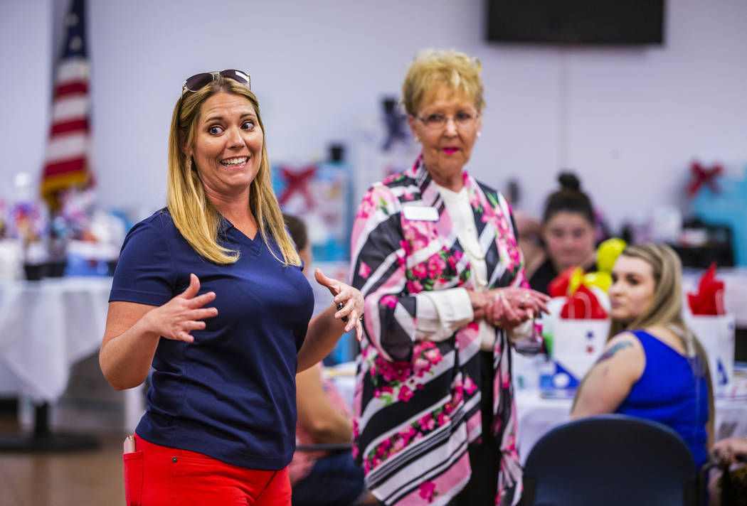 Michelle Hagge with Operation Homefront and Margie Manning with Blue Star Families welcome thei ...