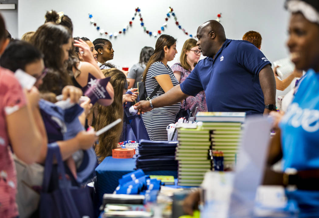 Eric Johnson with USAA distributes small gifts and information during the Operation Homefront s ...
