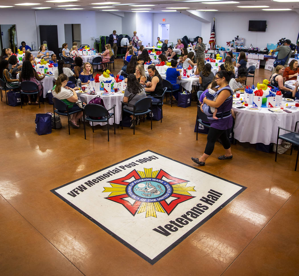 Invited guests enjoy lunch and a few speakers during the Operation Homefront sponsored Star-Spa ...