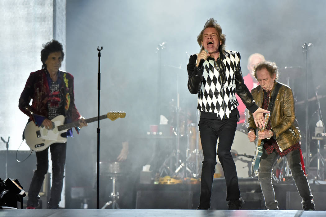 Mick Jagger, Charlie Watts, and Keith Richards of The Rolling Stones performs during the &quot ...