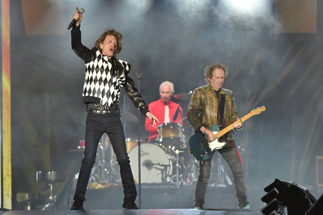 Mick Jagger, from left, Charlie Watts, and Keith Richards of The Rolling Stones performs during ...