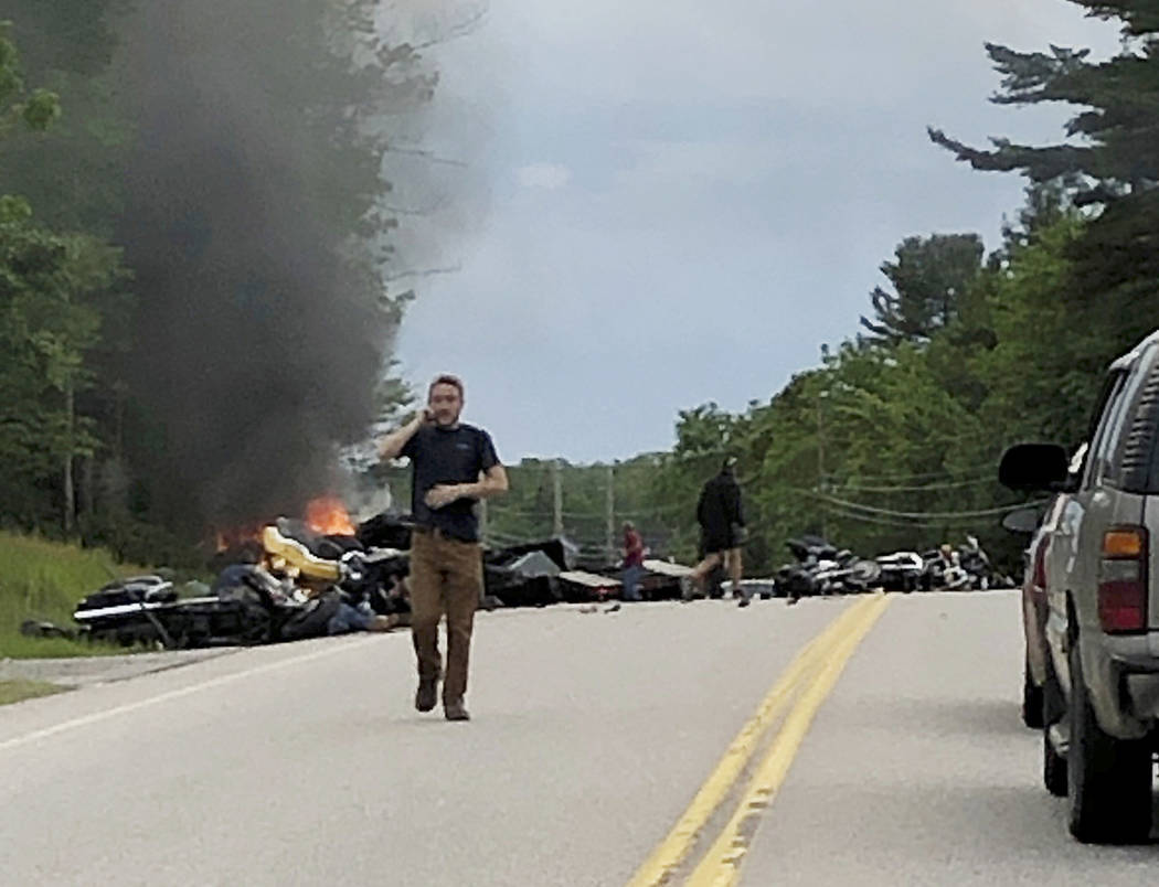 This photo provided by Miranda Thompson shows a man talking on his cellphone at the scene where ...