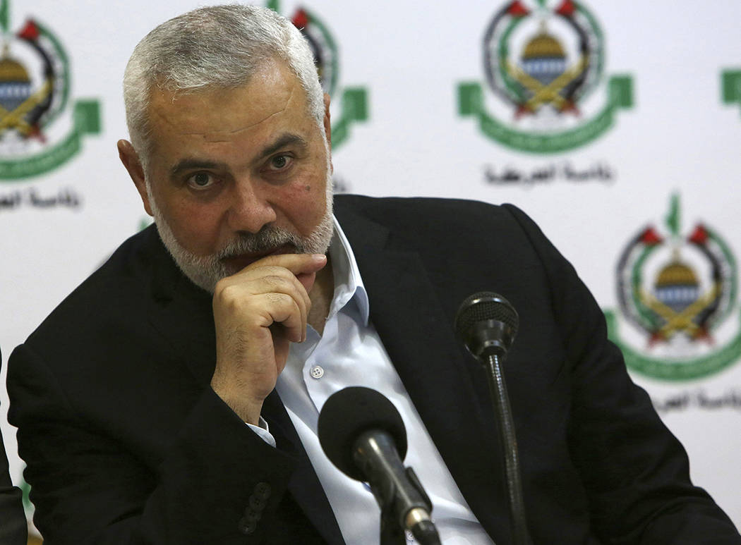 Hamas' chief Ismail Haniyeh attends a meeting with foreign reporters at al-Mat'haf hotel in Gaz ...