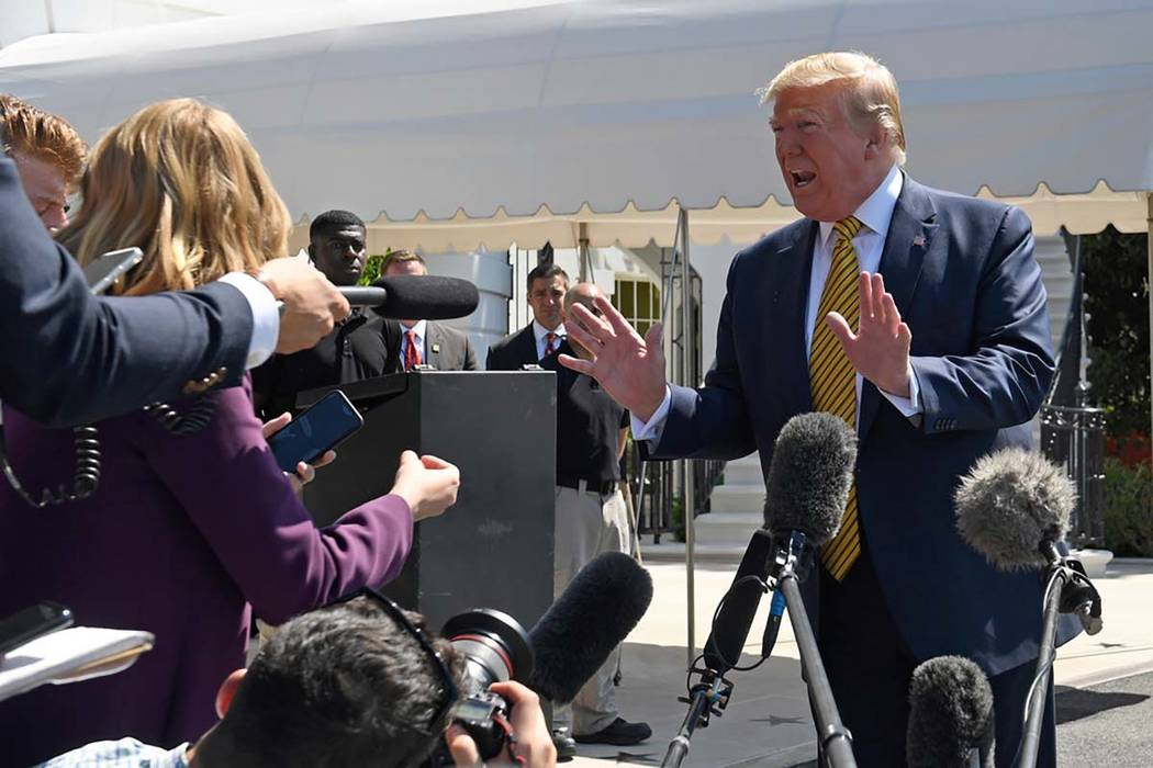 President Donald Trump speaks to reporters on the South Lawn of the White House in Washington, ...