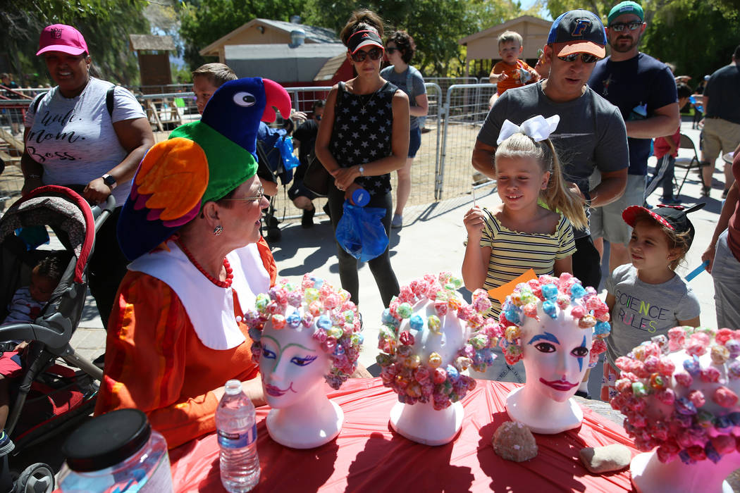 Volunteer Carol Bell, from left, talks to Gianna Bertuccini, 7, and her cousin Anna Rosenberg w ...
